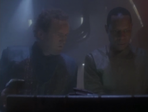Sisko does something with a computer!