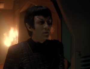 The commander of the Romulans was really a Founder! He helps Odo get out