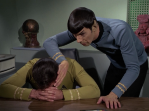 Kirk is sad. Spock sneaks in a mind meld while he's asleep and makes him forget about the girl