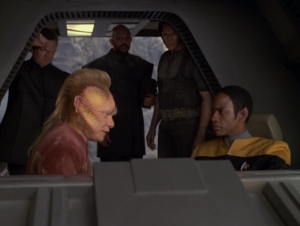Neelix and Tuvok crash on their planet. Some other people are there too