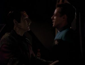Bashir runs into Quark and Garak, but they just leave