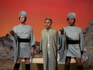 Kirk and Spock are rescued by some of the people that live in the sky cities. The guards have really terrible costumes