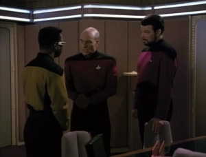 Geordi and Riker REALLY don't like Barclay. They keep calling him Broccolli and say they don't want to be in the same room with him. Picard basically tells them to stop acting like babies