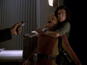 They go to the elevator and there's a lady living there. They mainly talk about what needs to be repaired, but she holds a knife to Neelix's throat the whole time. I like this lady
