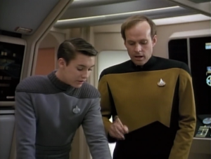 Geordi invites Barclay to a meeting. They try to figure out why stuff is breaking. Wesley asks if Barclay considered to flow capacitor