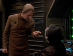 Odo figures out that Garak blew up his own shop to get Odo to help him out