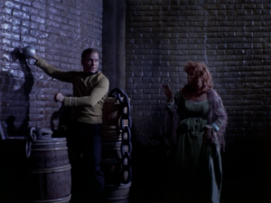 Kirk can hear Bones and Spock when he stands next to a wall. People think he's a witch because the voices talked to him