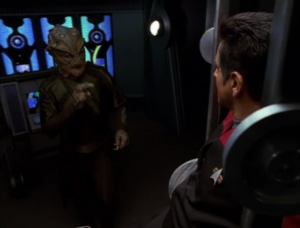 But the lizard guy that got away took Chakotay with him. He talks to him about the sitution with the authorities, and asks if Chakotay will go with him as evidence