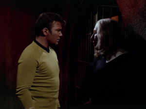 The same information is said to Kirk, but Kirk said that he wasn't changed before going through the portal. I guess Spock couldn't figure it out