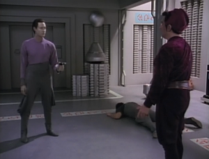 Data manages to get the gun. The guy knows Data won't shoot him though