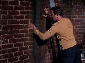 Kirk finds the portal and goes back through