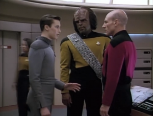 But then he figures out how to find Riker and Troi, so he has to stay