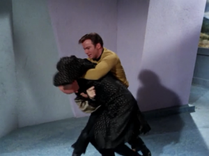 Kirk fights the old guy. I don't really see why they had to be at odds