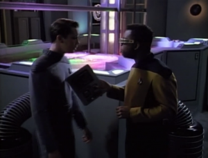 Wesley and Geordi start to fight. Wesley brings up Geordi's holodeck girlfriend