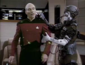 The Borg come aboard and take Picard!