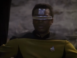 Geordi links with him to stabilize him or something