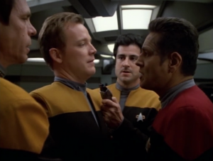 Paris goes through the holo-novel too, only he takes Janeway's side