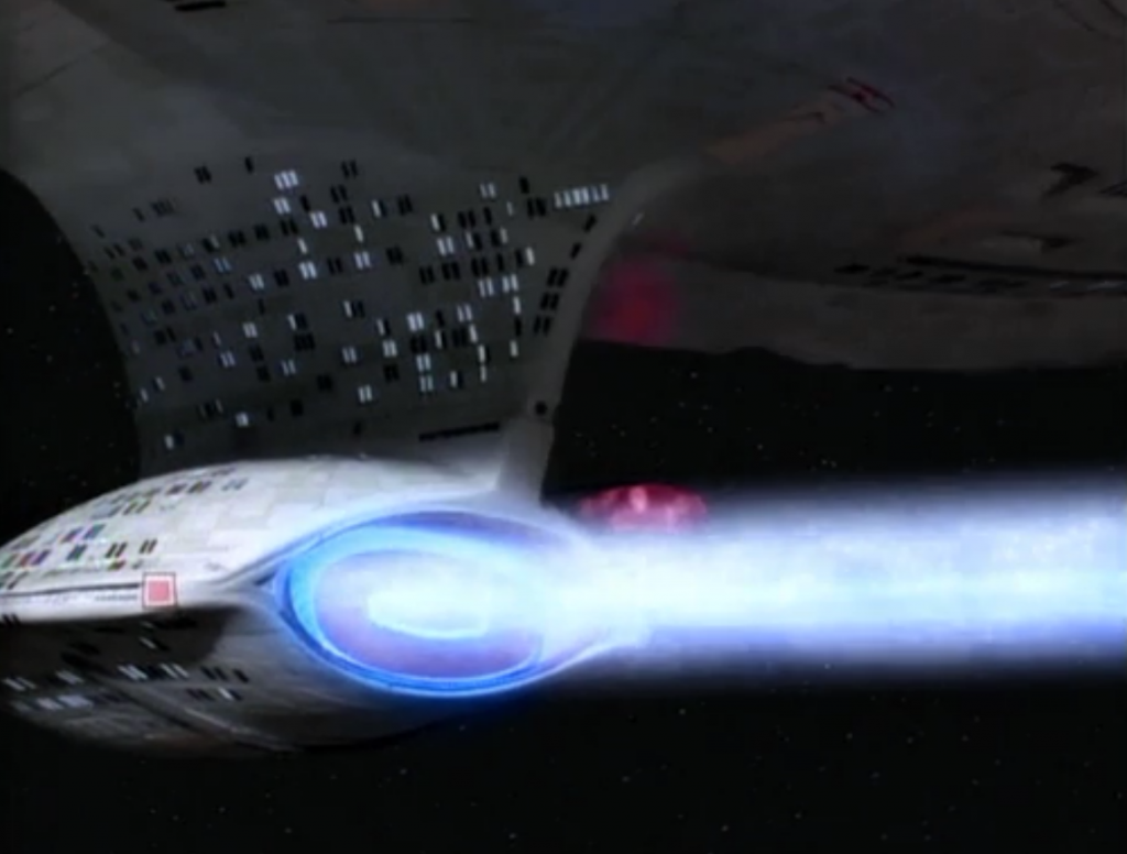 Enterprise fires it's super laser that Geordi had been working on, but it doesn't do anything