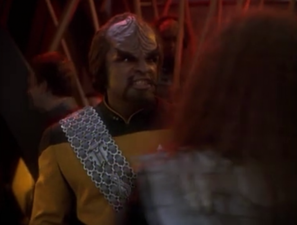Worf beats up the trouble-maker Klingon