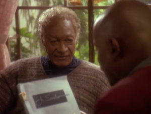 Jake gives some analogies to he and his father being connected like an elastic band, or Jake being like an anchor or something. The rules are that if Jake dies while Sisko is in normal space, then he'll be sent back to when the incident first happened