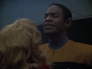 Tuvok gives her a quick mind meld to slow her time bomb or something