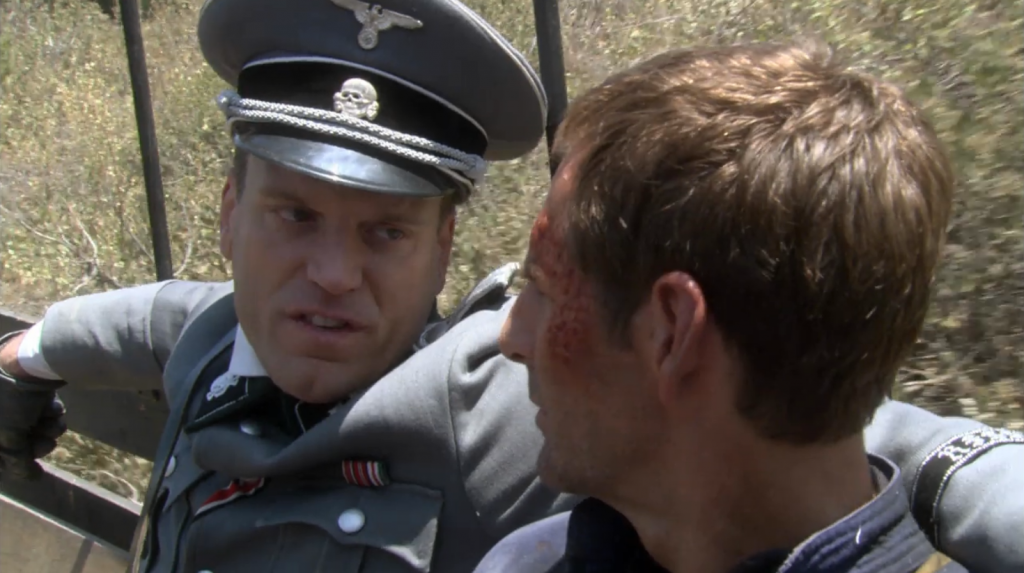 The Nazis are transporting Archer somewhere. This is the look of someone in the middle of a sick burn