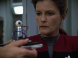 The Doctor helps Janeway set up her webcam
