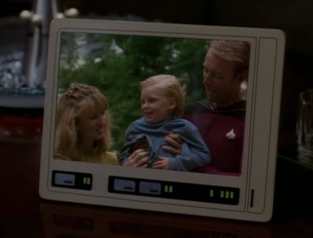 Picard shows him that he's a human and the Talarians killed his parents