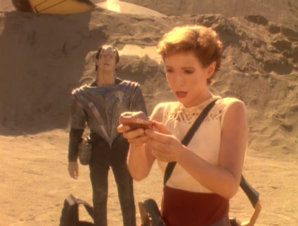 Kira looks at a device and it points her to where the survivors might have gone