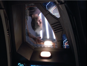 B'Elanna checks the lower decks and finds the dead crew