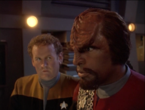 Worf shows up in engineering. The story arc here is to show how engineers don't respond well to strict oversight like on the bridge