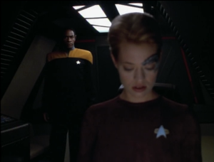 Tuvok beams aboard her shuttle, and after she puts him to sleep with a vulcan neck pinch,  they try to talk about things