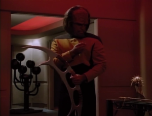 Worf grabs his bat'leth and takes off his starfleet pin. oh man