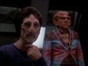 Quark and the alien business man get stuck together