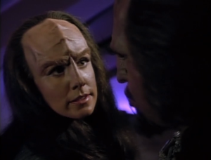 Worf is the boy's father, but he can't claim him because than he would share in Worf's dishonor. K'Ehleyr doesn't buy that Worf gave up the fight for his father's honor