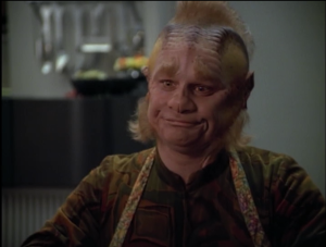 Neelix tries to show her what swallowing is. He makes it look really hard
