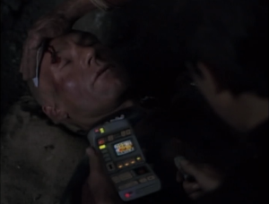 Picard saves Weasly from falling rocks and is knocked out