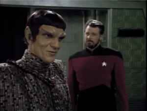 Tomalak is the Romulan in charge of the peace agreement. Riker doesn't like this