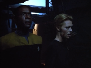 Tuvok covers Seven from an explosion and ends up losing his sight