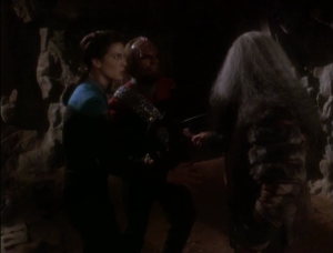 Worf thinks maybe he should lead the Empire. Things only get worse, until finally they just fight each other. What's going on here? Does the sword put some kind of spell over Klingons? Why is Worf acting totally crazy?