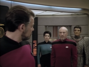 He tells Picard to shut up!