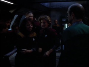 But Voyager escapes. Janeway gives the order for the crew to split up and meet on the other side of these alien's space, in order to increase to chance of survival