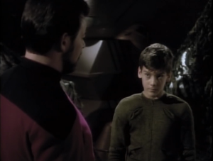 The kid accidentally called Tomalak an ambassador, which was only true in the holoprogram the Romulans invented. Riker calls this kid out