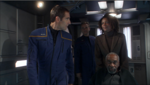 Enterprise welcomes the guy who invented the teleporter. He's not super short or anything, he's in a wheelchair. Probably could've got a better screenshot