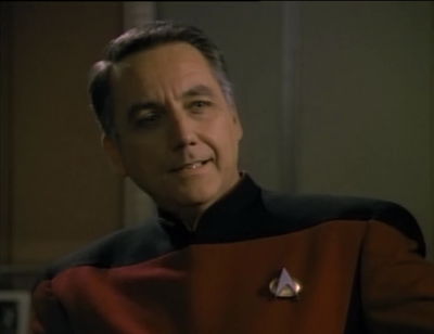 He says the cardassians are up to something. Those cargo ships aren't so innocent