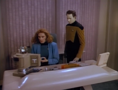 Data is put in charge of figuring out what happened with the transporter. He figures out she didn't really die, and that the Romulans transporter her over