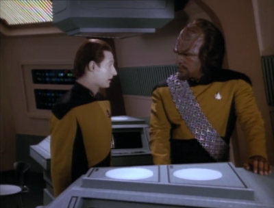He goes to some kind of store to ask Worf for advice on getting a wedding gift