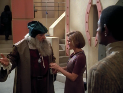 While trying to locate their stuff, Janeway goes to a market and finds da Vinci with the mobile emitter