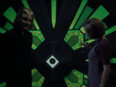 Janeway finds Voyager's computer and poses as someone who wants to buy it