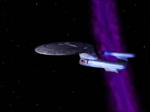 The particles are pulling Enterprise into a cosmic string. It will destroy them!